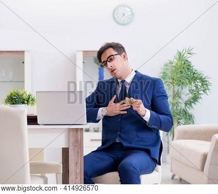 Bankrupt businessman having heart attack at home