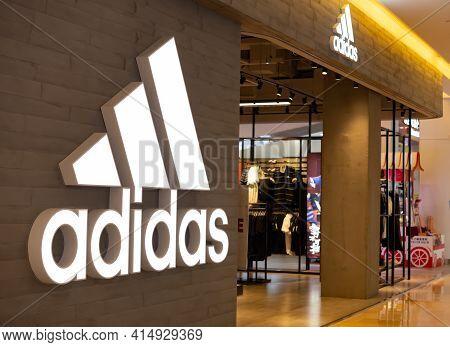 Zhongshan Guangdong China-march 30 2021:adidas Logo And The Shop In A Shopping Mall.