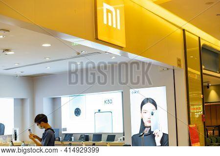 Zhongshan Guangdong China-march 30 2021:xiaomi Logo On Top Of The Shop In A Shopping Mall.
