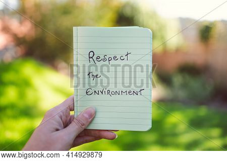 Sustainable Development, Hand Holding Respect The Environment Message Under The Sun With Garden Boke