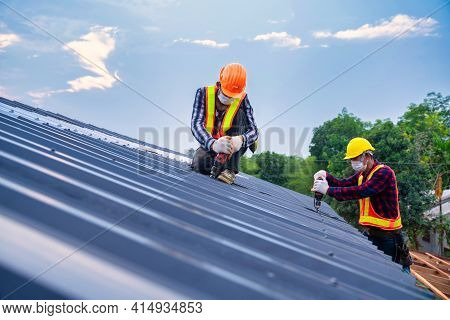Team Work Roof Concept Of Residential Building Under Construction, Roofer Worker Safety Wear Using A