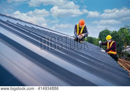 Two Roof Concept Of Residential Building Under Construction, Roofer Worker Safety Wear Using Air Or