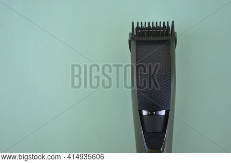 Top Angle Of Front View Of Beard Trimmer With Attached Comb With Negative Space, Trimmer Isolated Ov