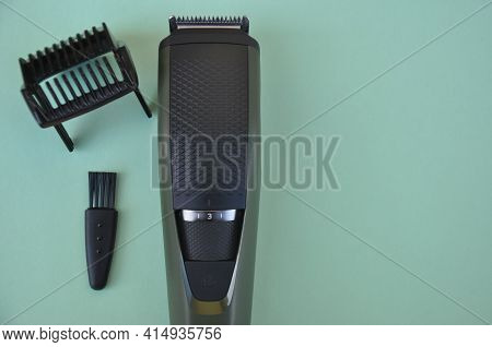 High Angle Shot Of Beard Trimmer With Comb And Brush With Negative Space, Hair Trimmer Isolated On G