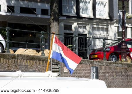 Amsterdam, Netherlands - July 02, 2018: Flag Of The Netherlands At The Stern Of The Boat