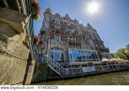 Amsterdam, Netherlands - July 02, 2018: View Of The Houses On The Embankment Of Amsterdam