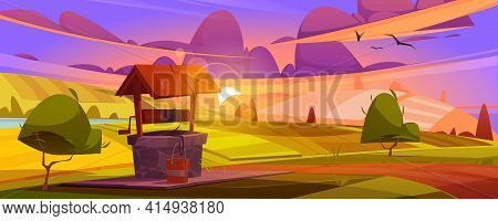 Old Stone Well With Drinking Water On Green Hill. Summer Morning Or Evening Landscape With Vintage R