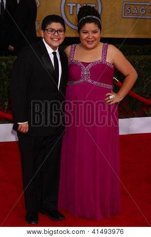 LOS ANGELES - JAN 27:  Rico Rodriguez, Raini Rodriguez arrive at the 2013 Screen Actor's Guild Awards at the Shrine Auditorium on January 27, 2013 in Los Angeles, CA