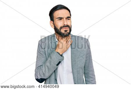Young hispanic man wearing business clothes touching painful neck, sore throat for flu, clod and infection