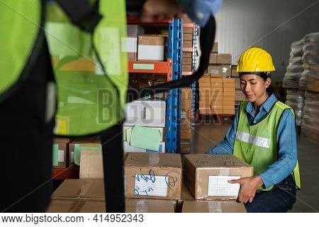 Female Warehouse Worker Working At The Storehouse . Logistics , Supply Chain And Warehouse Business