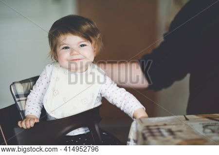Father Feeding Baby Girl From Spoon Mashed Vegetables And Puree. Food, Child, Feeding And People Con
