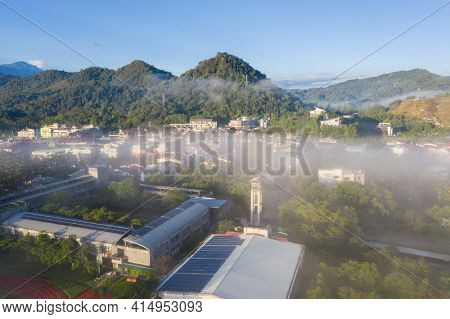 morning cloudy landscape with buildings under clouds and mist in Yuchi township, Nantou, Taiwan