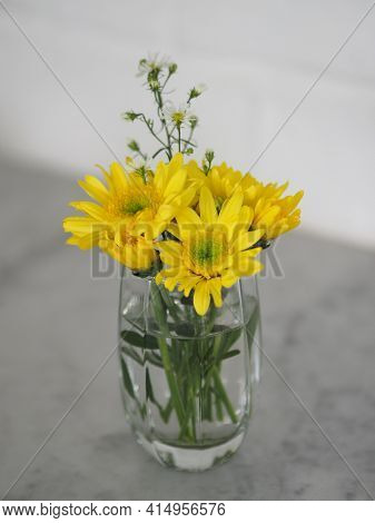 Yellow Gerbera Flower Beautiful Bouquet In Water Glass Colorful Beautiful On White Marble Table, Bar