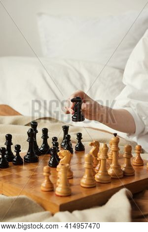 Chess Player Woman Learns Chess Opening By Playing With Himself. Black Horse One Step Forward. Chess