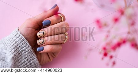 Hand In Sweater And Pink Flowers With Modern Manicure Nails. Female Hand. Glamorous Beautiful Manicu