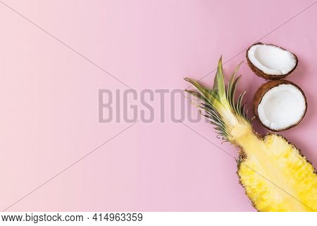 Flat Lay With Cut Halves Of Fresh Pineapple, Coconut On A Pastel Pink Background. Ingredient For Pin
