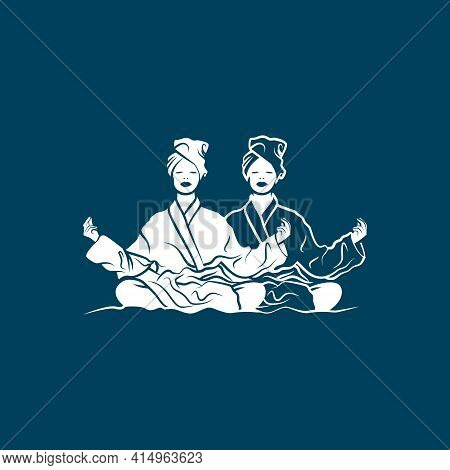 Two Girls In Lotus Position Meditate In Bathrobe And Take Spa Treatments.