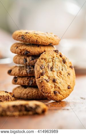 Tasty biscuits with chocolate. Sweet chocolate cookies on wooden table.