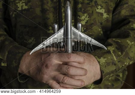 Military Technical Service, Air Force Concept. Hands Of A Man In Uniform Holding A Silver Toy Airpla