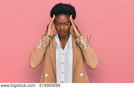 Young african american girl wearing business clothes suffering from headache desperate and stressed because pain and migraine. hands on head.