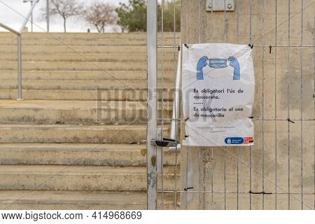 Son Caliu, Spain; March 21 2021: Sign Of Obligatory Use Of Face Mask At The Entrance Of A Sports Ven