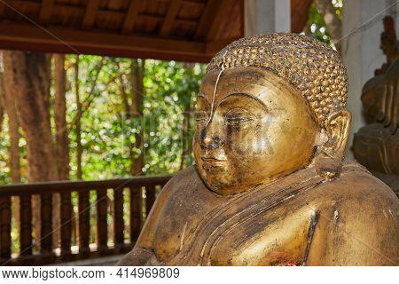 Phayao, Thailand - Dec 13, 2020: Headshot Front Left Gold Sangkajai Buddha Statue In Wat Analayo Tem