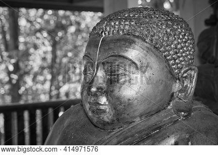 Phayao, Thailand - Dec 13, 2020: Black And White Zoom View Headshot Front Left Gold Sangkajai Buddha