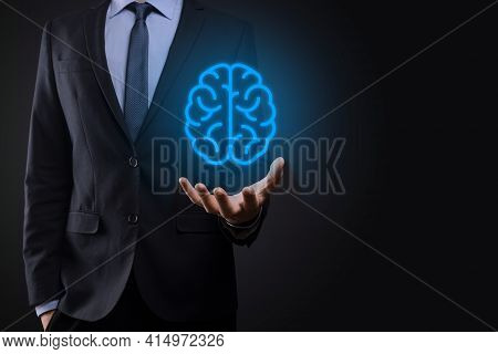 Businessman Holding Abstract Brain And Icon Tools, Device, Customer Network Connection Communication