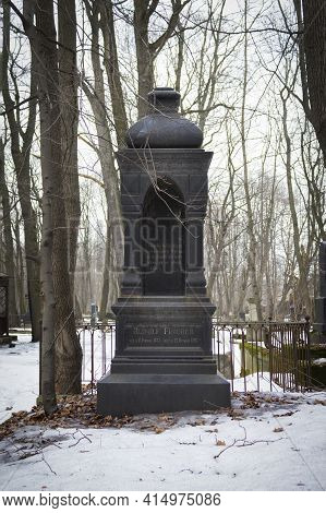 Black Grave Monument In Winter Cemetery Among Bare Trees - Smolenskoe Lutheran Cemetery, Russia, Sai