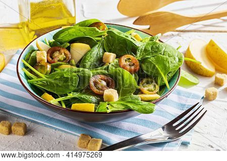 Appetizing And Healthy Low Calorie Vegetarian Salad With Spinach Sprouts, Fresh Apple, Tomatoes And