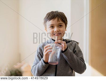 Healthy Kid Drinking Juice, High Key Light Portrait Cute Funny Boy Drinking A Fresh Soda Drink Throu