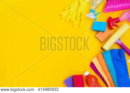 Colorful Cleaning Supplies Tools On Illuminating Yellow Background, Border With Copy Space, Spring C