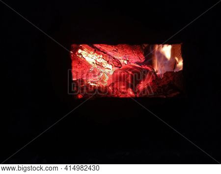 Wood Burning In The Dark, A Small Fire . Gas And Wood Burning Stoves In The Village Are Dangerous .