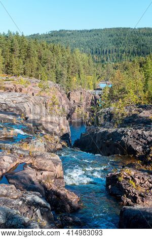 Storforsen, Wild, Huge Waterfall On The Pite River In Swedish Arctic On A Sunny Day Of Arctic Summer