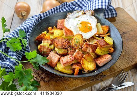 Fried Potatoes With Meat Loaf And A Fried Egg (so-called Bavarian Groestl), Often Served In A Pan