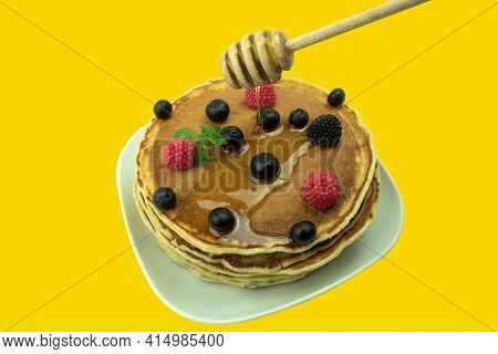 Pancakes With Fruit And Honey Isolated Background. Pancake. Pancakes With Berries And Syrup Isolated
