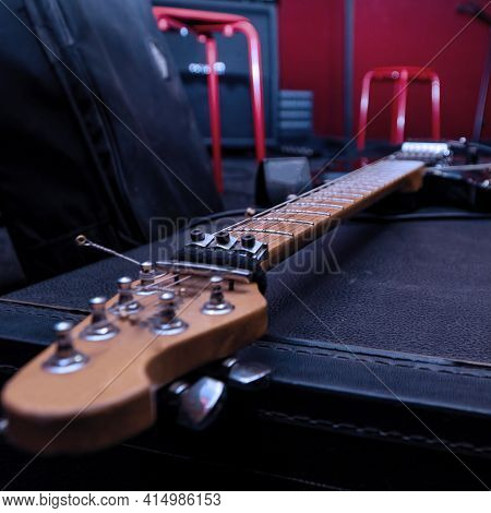 Headstock With Tuning Pegs Electric Guitar On A Hard Black Case. Selective Focus