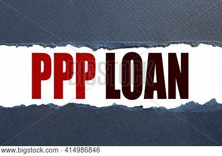 Ppp Loan. Text On White Paper Over Torn Paper Background.