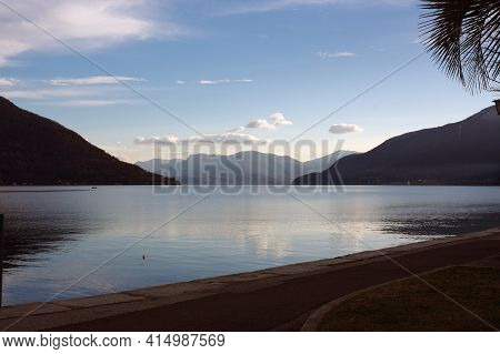 Swiss Area Of  Maggiore Lake, Clouds And Mountains