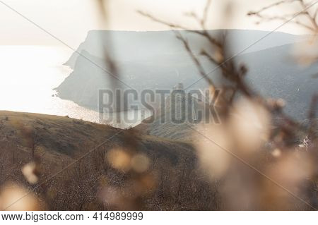 Spring Atmospheric Landscape In Neutral Shades. Panoramic View Of The Cembalo Fortress Through The A