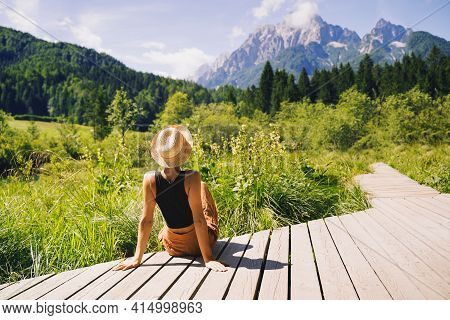 Travel, Freedom, Lifestyle Concept. Young Woman Enjoying Green Nature Outdoors. Amazing View On Zele