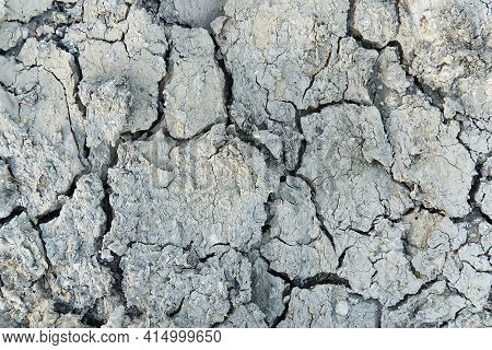 Closeup Of Dry Soil. Cracked Texture Of Ground. Ground In Drought, Soil Texture And Dry Mud, Dry Lan