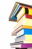 Lots of books stacked one over the other isolated on white poster
