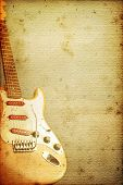 Beautiful guitar on old nostalgic background used look poster