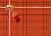 illustration of Scottish plaid gift wrapping with golden ribbon bow and red empty tag poster