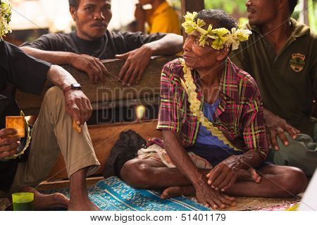 BERDUT, MALAYSIA - APR 8: Unidentified man Orang Asli in his village on Apr 8, 2013 in Berdut, Malaysia. More than 76% of all Orang Asli live below the poverty line, life expectancy - 53 years old.