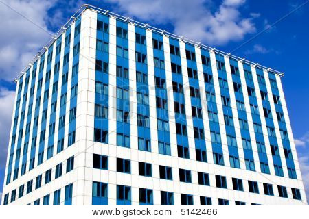 Modern blue office building corner and bright sky poster