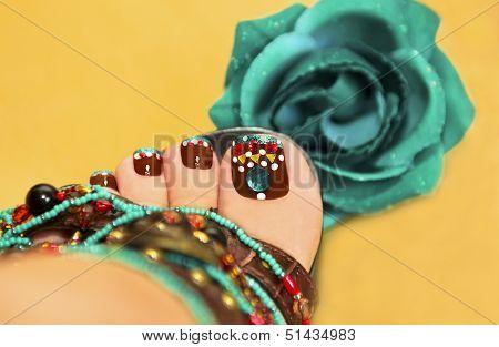 Brown turquoise design pedicure.