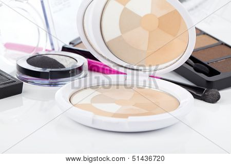Powder With A Brush On A White Background And Other Cosmetics