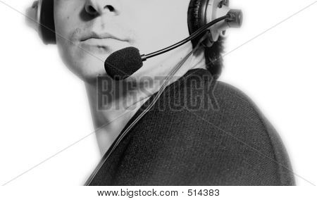 Man With Microphone And Earphone.Isolated On White